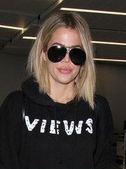 Khloe Kardashian looked a little mysterious in her oversized Porsche aviators as she arrived on a flight at LAX.