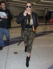 Khloe Kardashian pulled her airport look together with a pair of black lace-up boots by Giuseppe Zanotti.
