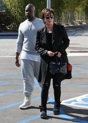 Kris Jenner's arm candy of choice was a luxurious black crocodile Birkin.