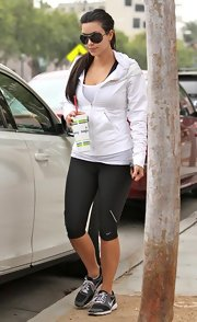 Kim hit the gym sporting cropped spandex athletic pants and a white tank.