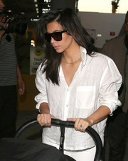 Kim Kardashian made a simple white button-down look so chic.