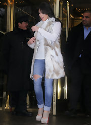 Kim Kardashian opted for distressed jeans and suede platform pumps.