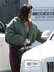 Kim Kardashian toughened up in a bulky green bomber jacket by Vetements for a day out in Calabasas.