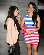 La La Anthony looked cool in a colorful striped mini dress during a dinner out with Kim Kardashian.