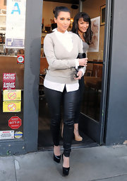 Kim Kardashian paired her skinny leather pants with black leather platform pumps.