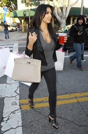 """The beautiful Ms. Kim totes one of her many """"Birkin"""" bags while shopping on trendy Robertson Blvd. Pricey bag in one hand, Starbucks in the other. How LA of her!"""