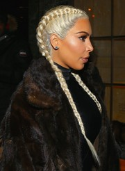 Kim Kardashian showed off her newly blonde locks, styled in a double French braid, while out and about in New York City.