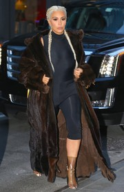 Kim Kardashian took a gangster-glam turn in a brown fur coat by Yeezy.