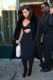 Kim Kardashian stepped out in the cold New York weather wearing a teeny-tiny corset top by Ulyana Sergeenko, topped off with a Celine fur coat for some warmth.