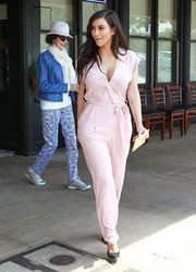 Kim Kardashian looked fetching in a belted pink Kardashian Kollection jumpsuit while out on a lunch date.