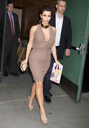 Kim Kardashian was ladylike chic in NYC. She donned a sexy taupe dress paired with a gold knuckle duster clutch.