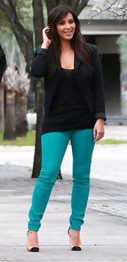Kim brightened up a basic black blazer with shocking teal skinnies.