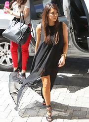 Kim Kardashian's strappy stilettos were a fierce finish to her tenty asymmetrical black dress.