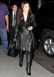 Kim Kardashian indulged her leather obsession with these knee-high zip-up boots.