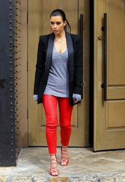 For a sexy finish, Kim Kardashian wore a pair of red strappy sandals by Alaia.
