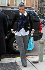 Kim wears a patterned scarf in such an elegant way with tis button-up blouse and cardigan.