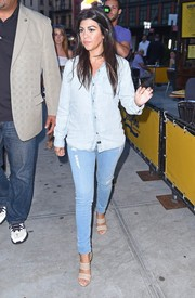 Kourtney Kardashian toughened up in a faded denim button-down while out to dinner with sister Kim.