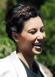 Kim Kardashian was all smiles in this lovely braided updo at church.