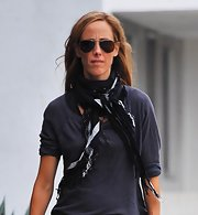 Kim Raver paired her casual look with a few patterned scarves while walking her dog.