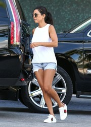 Kourtney Kardashian was spotted outside her Miami hotel looking breezy in a white Re/Done tank top and a pair of cutoffs.