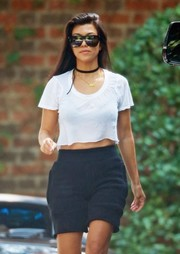 Kourtney Kardashian completed her relaxed look with black Yeezy shorts.