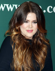 Khloe Kardashian wore a shiny warm pink lipstick at a book signing for 'Dollhouse.'