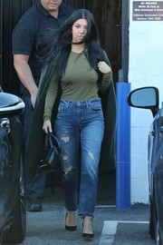 Kourtney Kardashian kept it simple in an army-green sweater while visiting a Van Nuys studio.