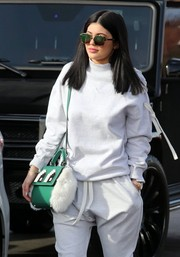 Kylie kept the rays out with a pair of Dior sunnies.