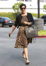 Kris showed off her wild side with an A-line leopard-print dress.
