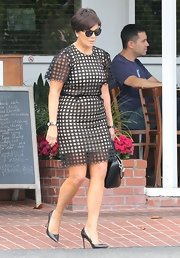 Kris Jenner wore this nude dress with black dot-cutout overlay while out in Hollywood.