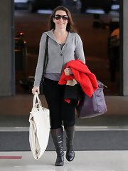 Kristin Davis opted for a simple gray sweater for her flight from LAX.