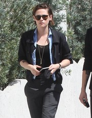 Kristen Stewart layered a black blazer over a blue button-down and a tank top for a day out in West Hollywood.