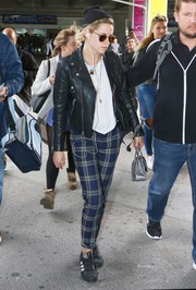 Kristen Stewart was spotted in Nice wearing blue plaid pants and a black leather jacket.