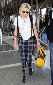 Kristen Stewart carried a brown and yellow duffel bag while making her way through LAX.