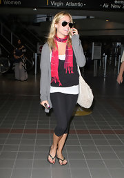 Kristin wore a vibrant scarf to brighten her comfy, travel ensemble.