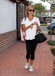 Kristin, dressed in athletic wear, toted the black pyramid studded Mister Stud Bowler Bag while out shopping in Brentwood.