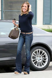 Kristin Cavallari showed off a monogrammed shoulder bag while leaving the hair salon.