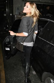 On a rainy day Kristin still finds time to shop. She was seen coming out of the Diesel store wearing a Rebecca Minkoff studded cross-body bag.