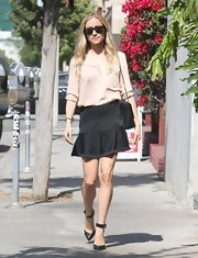 Kristin Cavallari makes running errands look stylish when she sported this chic black mini and a nude blouse.