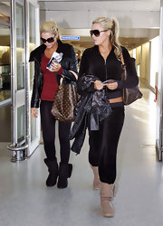 Karissa Shannon was comfily dressed in a black track jacket and matching pants during a flight out of London.