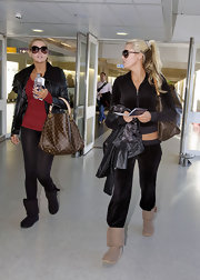 Karissa Shannon looked sporty-sexy in track pants and a matching jacket during a flight out of London.