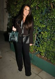 Kyle Richards tote had just a splash of color to liven up her dinner look.