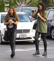 Kylie Jenner was spotted out wearing an olive-green Yeezus Tour merch T-shirt.
