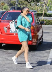 Kylie Jenner dressed down in a loose blue T-shirt from Kanye West's Pablo merchandise for a day out in Malibu.