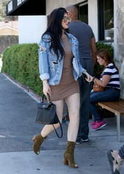 Kylie Jenner paraded her flawless pins in a tan mini dress by Enza Costa while out grabbing lunch.