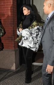 Kylie Jenner geared up for cold New York City weather with a down-filled camo parka by Vetements x Canada Goose.
