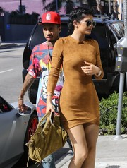Kylie Jenner rocked suede on suede with this tote and dress combo.