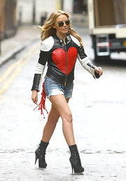 Kylie Minogue filmed her latest video while wearing a pair of lace up ankle boots.