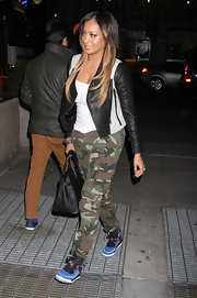 La La Anthony was sporty-edgy in a black-and-white leather jacket and camouflage pants during a Knicks game.