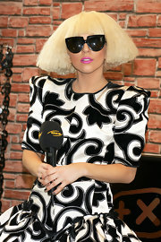 "The ""Fame Monster"" singer sported a blunt cut, straight wig with a platinum blonde hue and straight bangs."